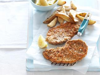 Oven-baked chicken schnitzel with spicy wedges