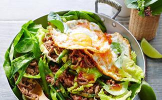 Stir-fry turkey with basil and fried egg