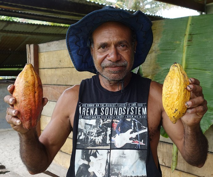 Phillip, from the Sanago fermentary, with some ripe cacao pods.