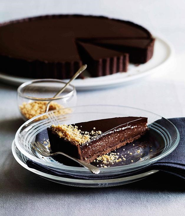 "[**Triple chocolate praline tart**](https://www.gourmettraveller.com.au/recipes/browse-all/triple-chocolate-praline-tart-10486|target=""_blank"") <br><br> A decadent tart of chocolate pastry filled with milk chocolate praline and topped with a dark chocolate cream, a perfect way to end a weekend dinner party."