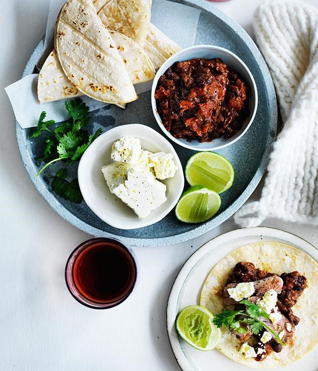 "[**Soft tacos with black bean mole and flank steak**](https://www.gourmettraveller.com.au/recipes/fast-recipes/soft-tacos-with-black-bean-mole-and-flank-steak-13581|target=""_blank"") <br><br> This taco recipe features warm, soft tortillas serve with a delicious mole sauce enhanced by the hidden elements of cinnamon, cumin and chipotle. The grilled flank steak is married perfectly with the soft tacos, feta and coriander for a Mexican inspired dish that ticks all the boxes."