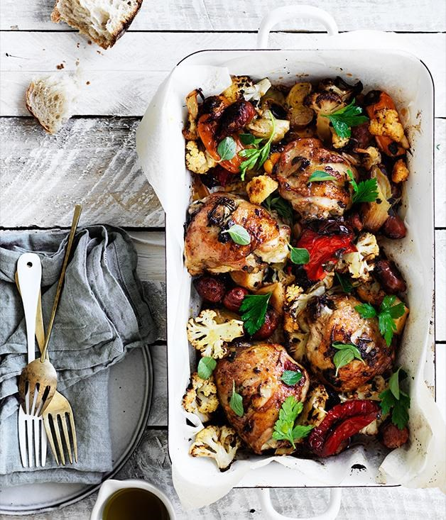 "[**Leek, chorizo, cauliflower and chicken bake**](https://www.gourmettraveller.com.au/recipes/fast-recipes/leek-chorizo-cauliflower-and-chicken-bake-13805|target=""_blank"") <br><br> No time to cook a roast? Think again. This chicken bake achieves a similar hearty feel in a fraction of the time by roasting everything in the same dish. It's a surefire winner."