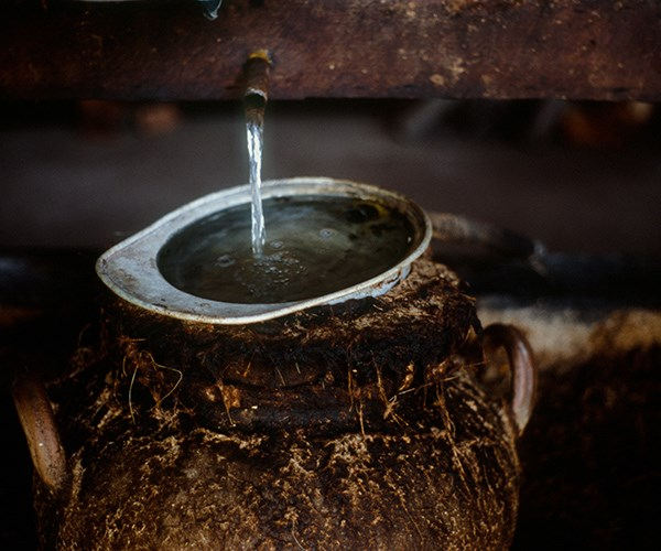 *Clay-pot stills being used to distil mezcal in Mexico*