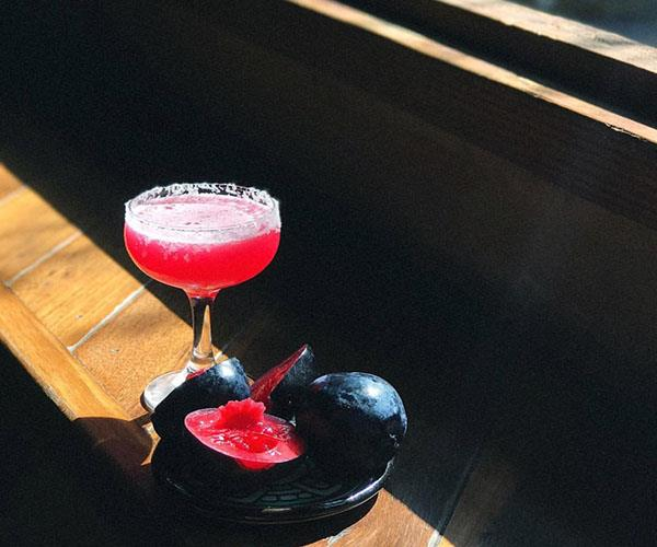 *A Native Plum Margarita at Tio's, made with Alipús San Baltazar mezcal, Davidson plum, lime and eucalyptus.*