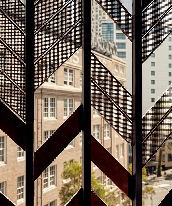 *Looking out to Surry Hills through the herringbone-patterned screen. Photo by Tom Ross.*