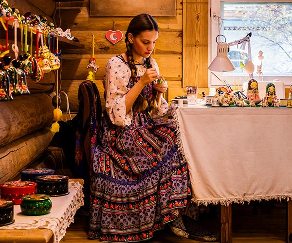 A girl paints matryoshka dolls in Uglich