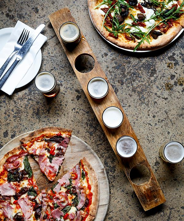 Wood-fired pizza and beer-tasting paddle at Boston Brewing Co