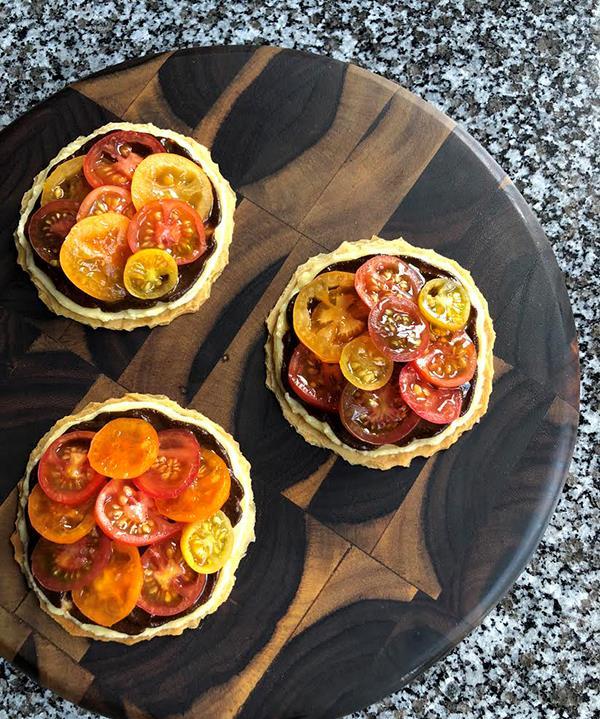 Attica's Salada crackers with tomato and Vegemite