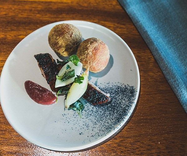 Cory Campbell's roast duck with tyrant ant honey and yam and millet cakes with crisp saltbush and onion