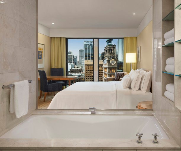Tower rooms feature glass-walled baths and signature Heavenly beds