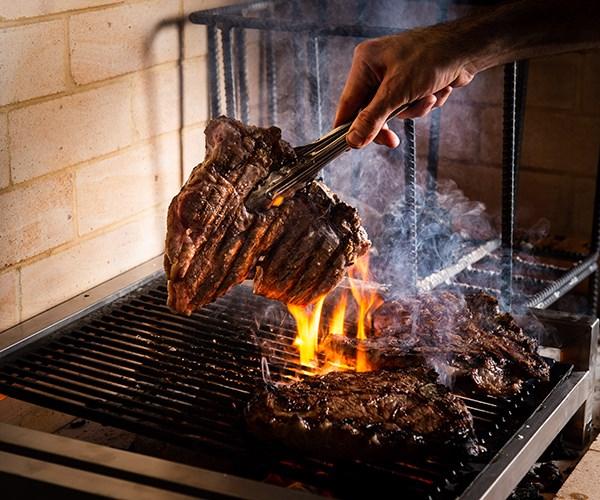 The steak is cooked until medium-rare at Bistecca.