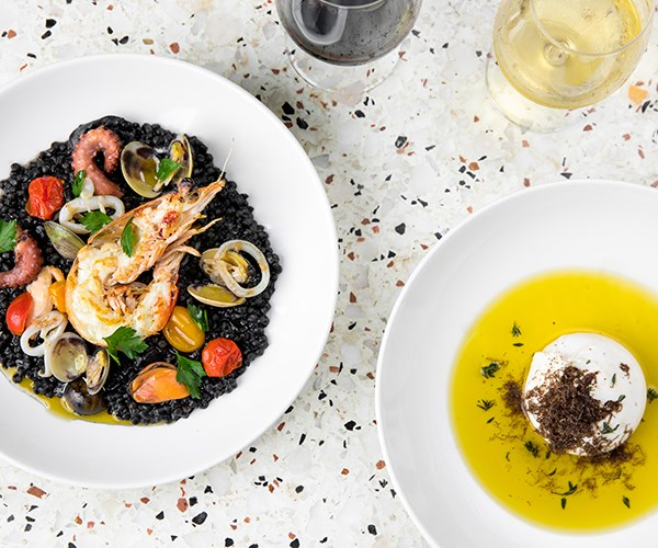 Squid ink fregola with frutti di mare (left) and burrata with black truffle