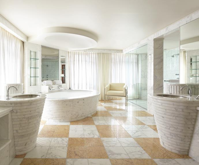 Italian marble makes its mark in the Presidential Suite bathroom.
