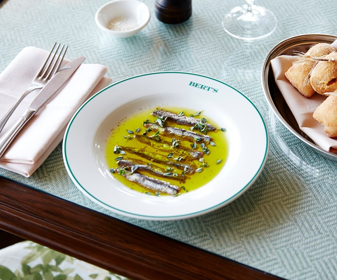 Anchovy fillets with lemon-thyme oil and black pepper served with fried buns