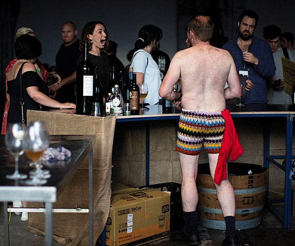 Automata sommelier Tim Watkins and crocheted shorts. The face of the woman at the bar says it all: speechless.