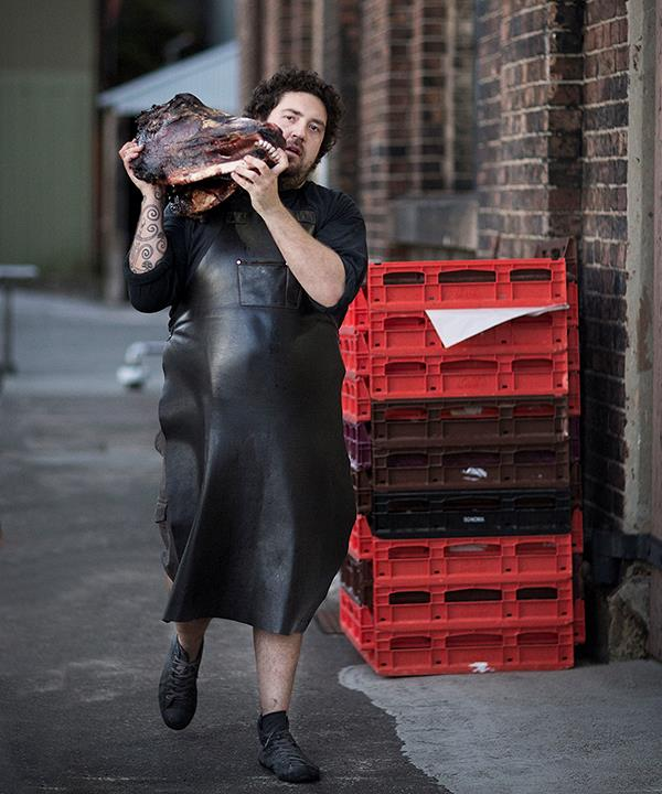 Africola chef Duncan Welgemoed carries the beast's head to the finale feast at Rootstock number three.