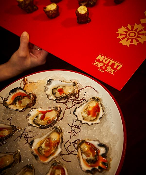 *Oysters with tomato vinaigrette (photo: Lauren Trompp).*