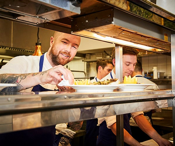 *Hubert chef Dan Pepperell on the pass (photo: Lauren Trompp).*