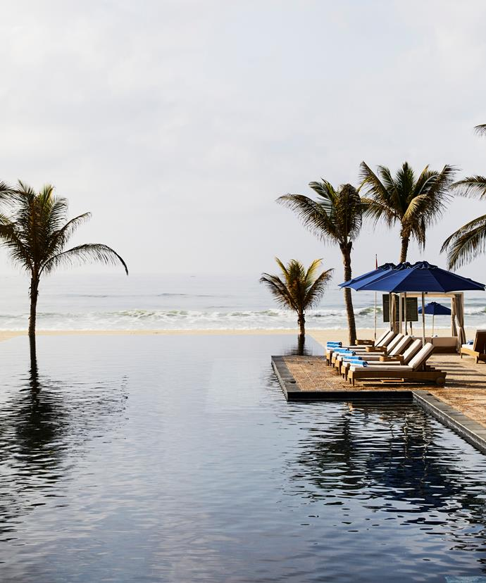 The central infinity pool at Al Baleed Resort Salalah by Anantara overlooks the private beach