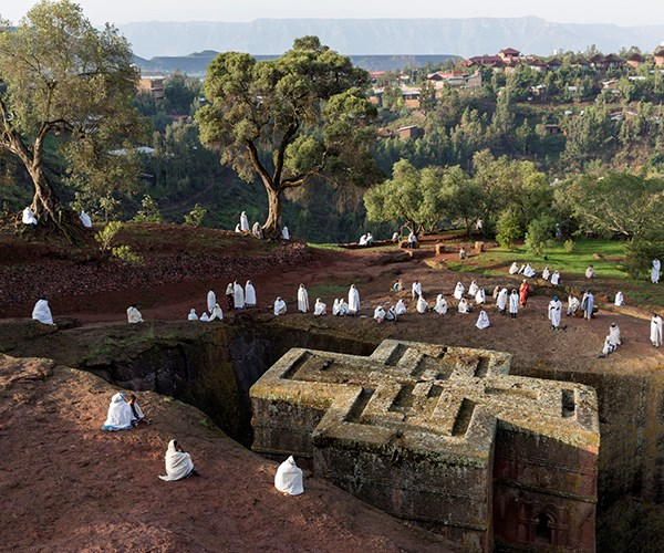 "**LALIBELA, ETHIOPIA**<br> ""The Church of Saint George is the magnificent centrepiece of the Lalibela monolithic rock-hewn churches, built in the late 12th century by King Gebre Mesqel Lalibela in Ethiopia's north.<br><br> ""Remarkably, the church is carved from a single piece of volcanic rock. The cross at ground level is actually the roof; the entrance is 30 metres below and part of a maze of underground tunnels. It's one of 11 rock-hewn churches carved in two clusters - an attempt by the king to build his own version of Jerusalem.<br><br> ""This shot was taken on a Sunday morning, immediately after a service attended by scores of Christian pilgrims. It was a real privilege to be at this most holy of sites.""<br><br> *Tom Parker, [tomparkerphotography.com](https://www.tomparkerphotography.com/