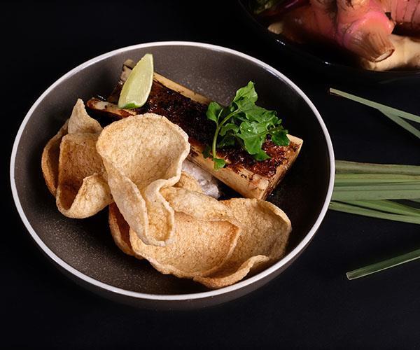 Prawns in pad see ew, bone marrow at Restaurant Moon (photography: Jessica Vuong).