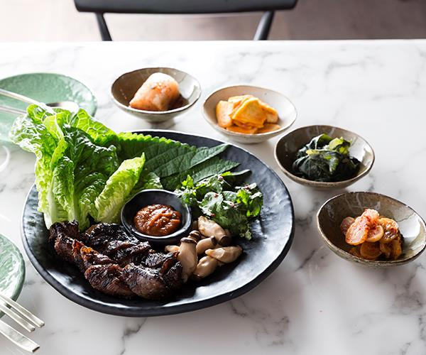 Wagyu intercostal with kimchi and pickled vegetable sides at Shik (photography: Greg Elms).