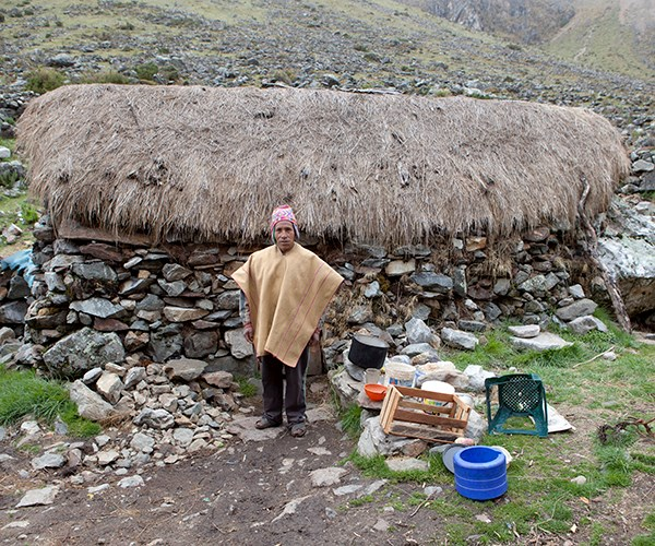 A villager in Salkantay Pampa outside his home