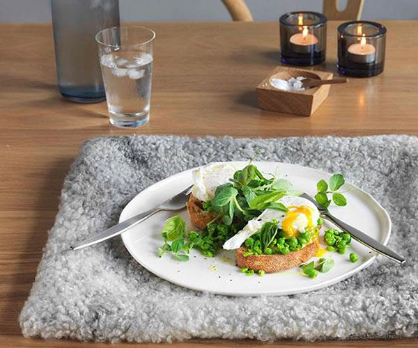 Crushed peas, basil and poached eggs on sourdough (photography: Jason Loucas)