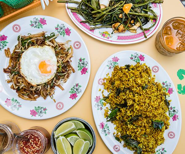 Clockwise from left: Rice drop noodles with fried egg, pumpkin stems with salted egg yolk and turmeric fried rice.
