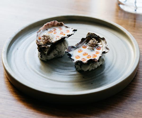 Rock oyster, coconut curry vinaigrette, eschalot, Tasmanian pepper leaf