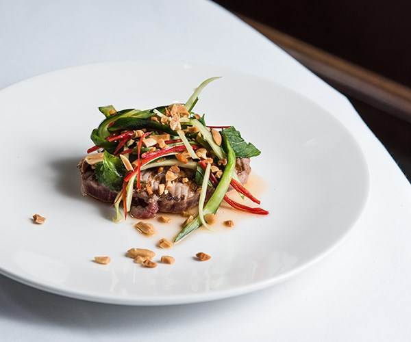 Char-grilled tuna with spicy cucumber peanut salad