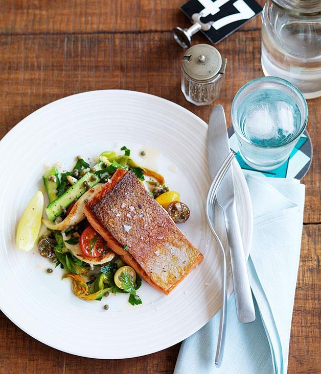 """**[Ocean trout with calamari, cherry tomato and zucchini flower salad](https://www.gourmettraveller.com.au/recipes/chefs-recipes/ocean-trout-with-calamari-cherry-tomato-and-zucchini-flower-salad-9016