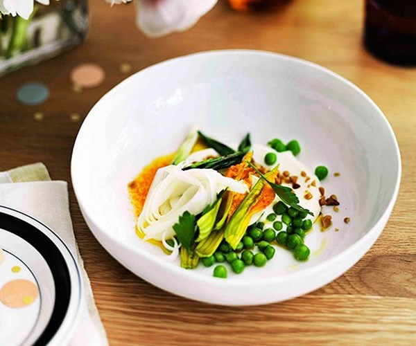"""[Pea salad, curd, pine nuts, blossoms, white asparagus and carrot juice dressing](https://www.gourmettraveller.com.au/recipes/browse-all/pea-salad-curd-pine-nuts-blossoms-white-asparagus-and-carrot-juice-dressing-11227