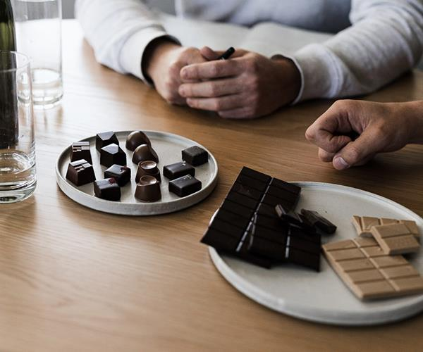 From left: a selection of pralines, lemon myrtle and Venezuelan 72% single origin block, and macadamia and spotted gum honey white chocolate block.