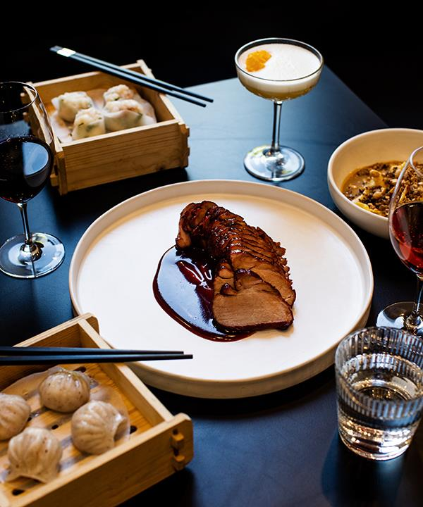 Truffle har gow, roast pork neck with char siu glaze. lobster and chive har gow, and duck egg noodles with strange-flavour sauce at Little Valley.