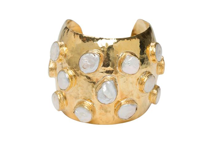 "Crafted with polished gold-tone brass and inlaid with pearls, the Adonie Cuff will lend a chic statement to after-hours style. <br><br> [Christie Nicolaides Adonie Cuff](https://www.christienicolaides.com.au/collections/bracelets/products/the-nereida-cuff-gold-pearl|target=""_blank""