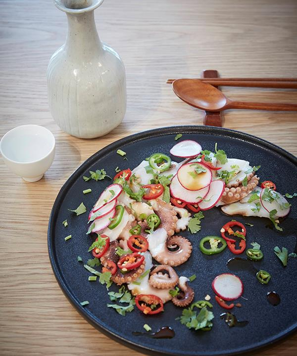 Moon-eo sook-hwe of octopus, red radish, chilli and coriander.
