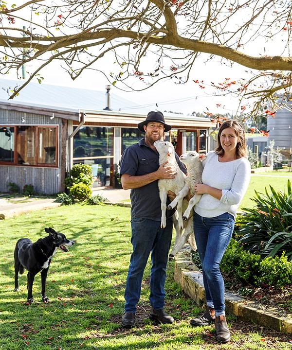 Glenarty Road co-owners Ben and Sasha McDonald with dog, Bob, and lambs Gnocchi and Rosemary.