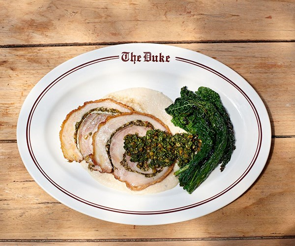 Roast porchetta with white beans and salsa verde