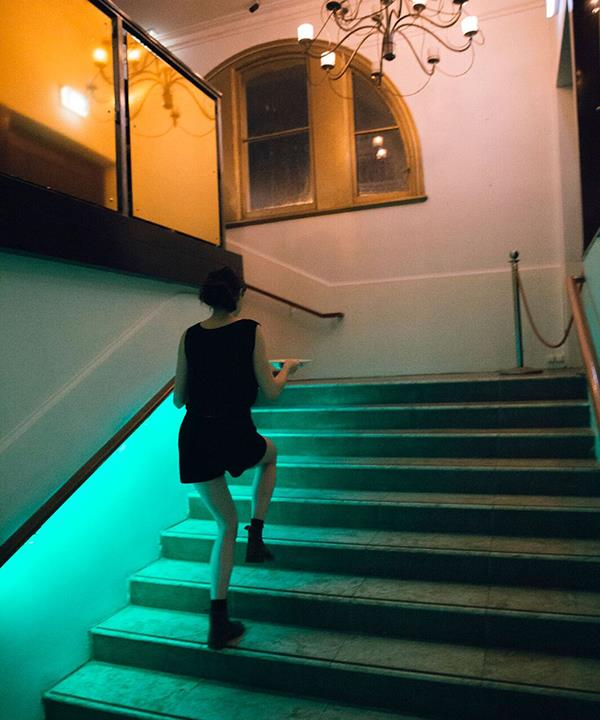 The neon-lit staircase at Don Peppino's.