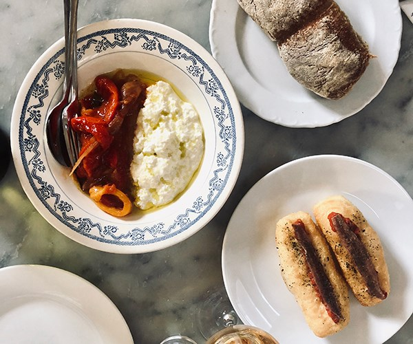 Ricotta with peperonata, garlic bread, pane fritto with anchovy. Photo: Harriet Davidson