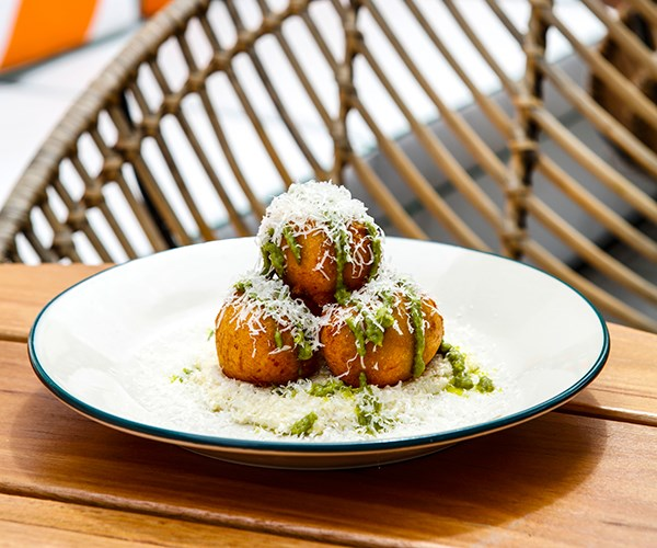 Parmesan and potato zeppole with white ricotta pesto