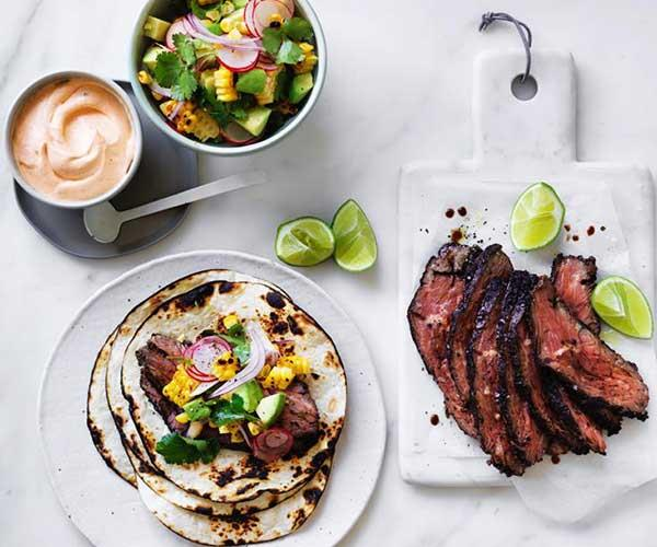 "[Flank steak tacos with corn, avocado and coriander](https://www.gourmettraveller.com.au/recipes/fast-recipes/flank-steak-tacos-with-corn-avocado-and-coriander-13851|target=""_blank"")"