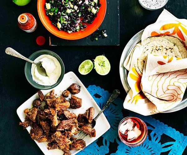 "**[Carnitas tacos with black bean salad](https://www.gourmettraveller.com.au/recipes/browse-all/carnitas-tacos-with-black-bean-salad-11193|target=""_blank"")**"