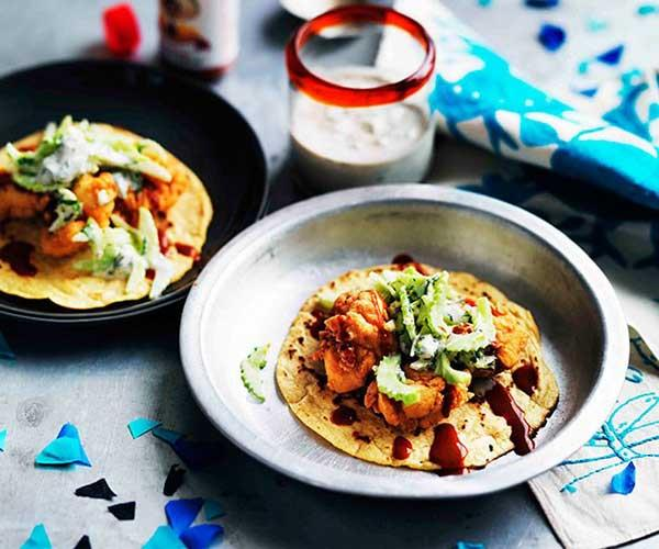 "**[Popcorn chicken tacos with blue cheese-buttermilk dressing](https://www.gourmettraveller.com.au/recipes/browse-all/popcorn-chicken-tacos-with-blue-cheese-buttermilk-dressing-11228|target=""_blank"")**"