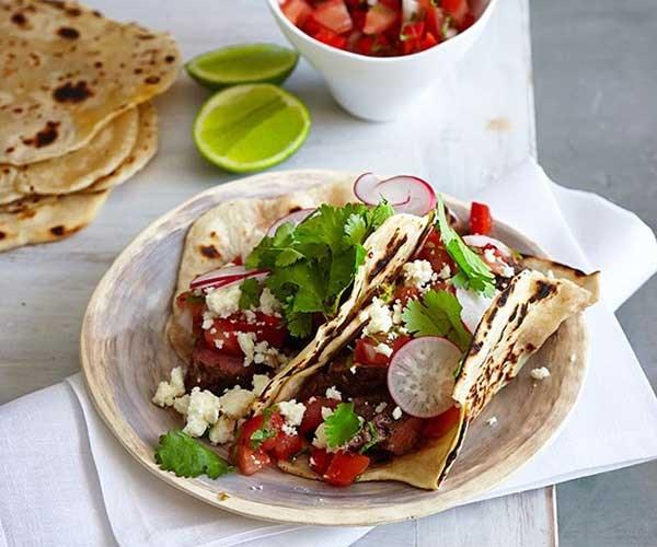 "**[Carne asada tacos](https://www.gourmettraveller.com.au/recipes/fast-recipes/carne-asada-tacos-13423|target=""_blank"")**"