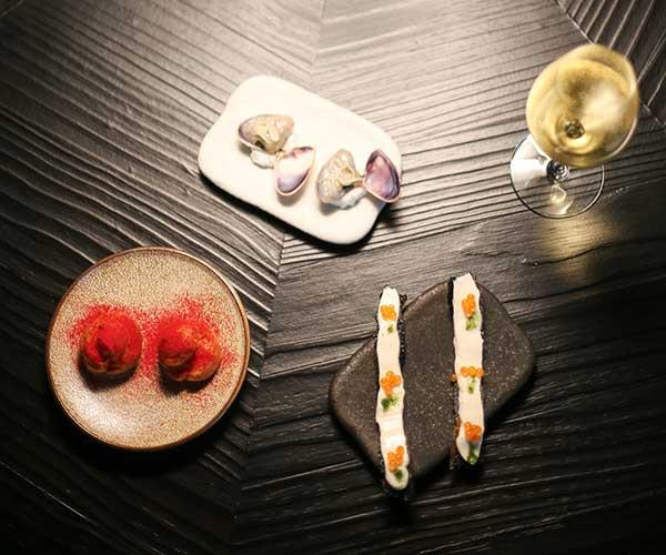Clockwise from top: pipi, cod roe on nori and chicken liver, umeshu profiteroles (Photo: Jess Kneebone)