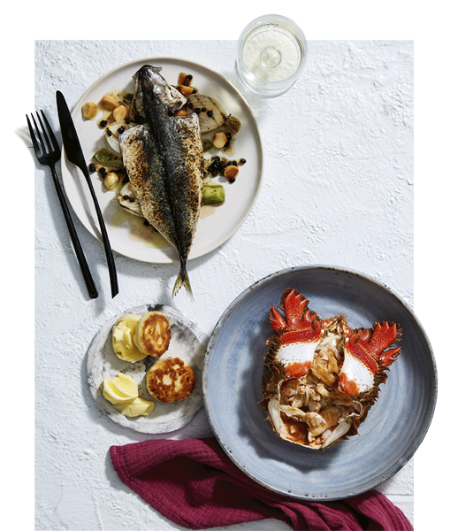 Josh Niland's sweet and sour blue mackerel and spanner crab with crumbed garfish yoghurt tartare and herb salad.