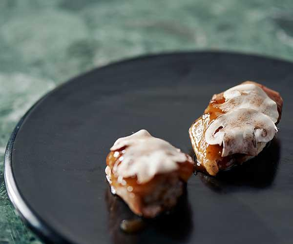 """**Chicken wings, kombu and salmon caviar**  """"These are great snacks – boned and stuffed with chicken mousse, then braised with kombu and topped with the roe."""""""
