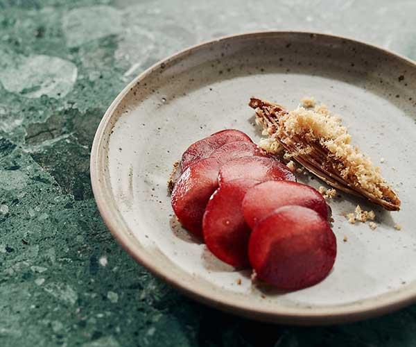 """**Kangaroo, Davidson plum, endive, macadamia**  """"This is like an ode to Australia. We dry out the fillet until it's almost like pastrami then serve it with the plum, caramelised endive and shavings of macadamia nut."""""""
